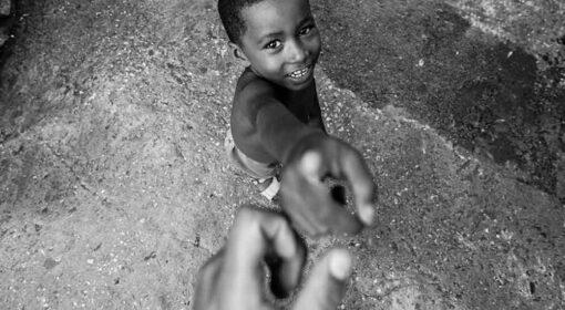 spiegare la carità ai bambini